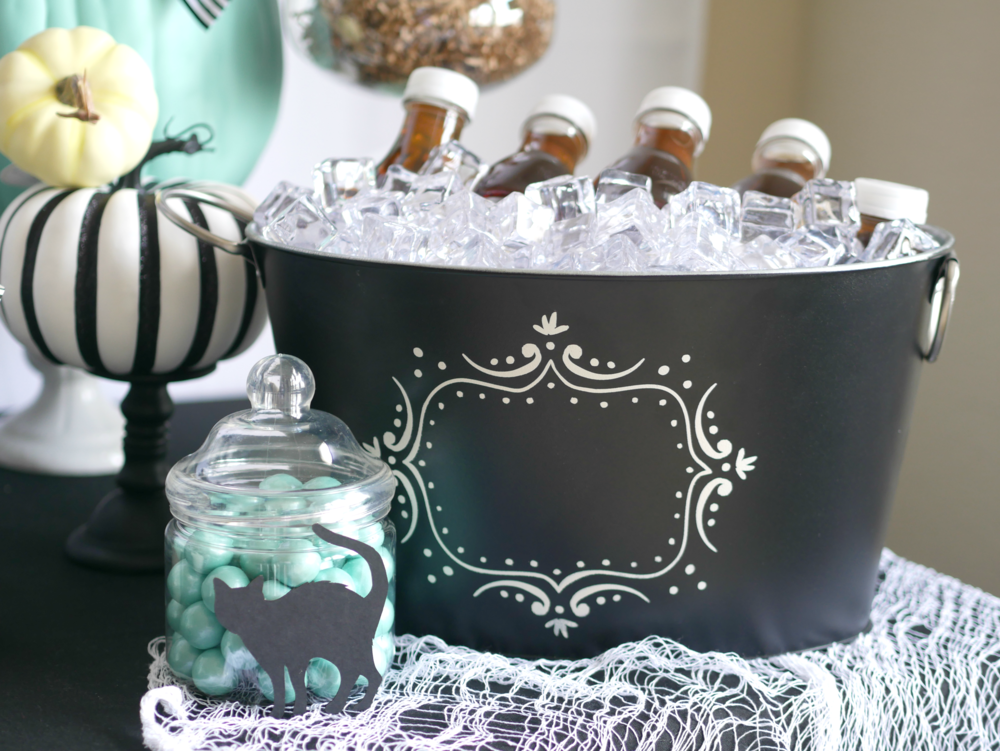 Loving the details at this modern halloween party. Using a black bucket for the drinks and ice created the look of a witch's cauldron. Come see the entire Halloween party by stylist Mint Event Design. #halloweenparty #partyideas #partyinspiration #halloween #halloweenideas #halloweendecor #halloweendecorations #halloweendrinks
