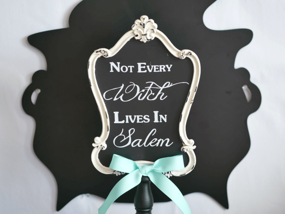 """This sign reads """"Not Every Witch Lives in Salem"""" and was the Halloween Party Inspiration that set the stage for the entire party. Adding the sign to a stand helped create the focal point on the Halloween dessert table. See the entire Halloween set-up by party stylist Mint Event Design. #halloweenparty #partyideas #partyinspiration #halloween #halloweenideas #halloweendecor #halloweendecorations"""