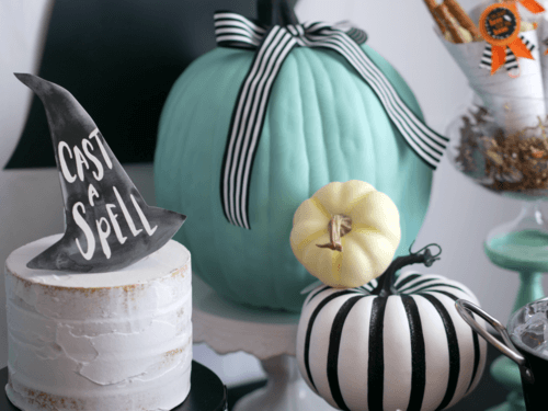 Loving the pops of teal at this Modern Halloween Party. Adding a black and white striped bow on top created the perfect contrast. Come see the entire Halloween party by stylist Mint Event Design. #halloweenparty #partyideas #partyinspiration #halloween #halloweenideas #halloweendecor #halloweendecorations #halloweenpumpkins