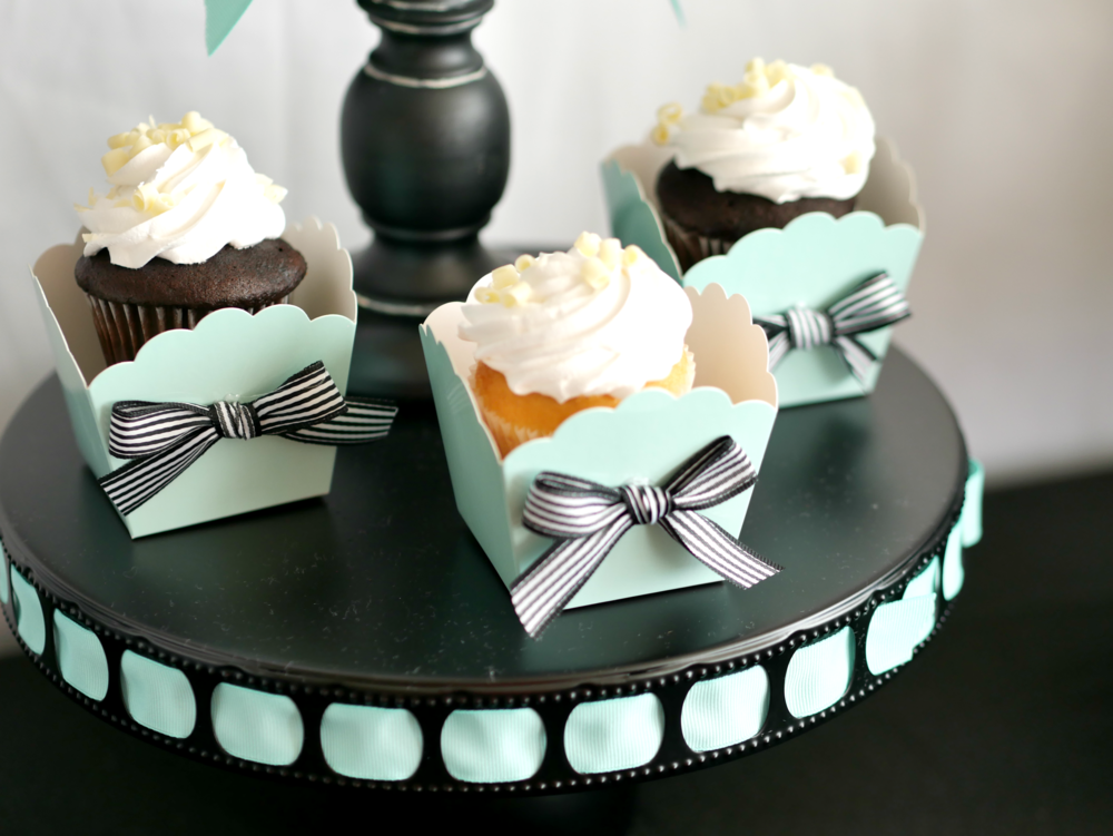 Give your Halloween party a sophisticated and girly look by combining the teal color with black and white striped ribbon for added texture and fun detail. Come see even more Halloween party tips from stylist Mint Event Design. #halloweenparty #partyideas #partyinspiration #halloween #halloweenideas #halloweencupcakes #tealpumpkinproject