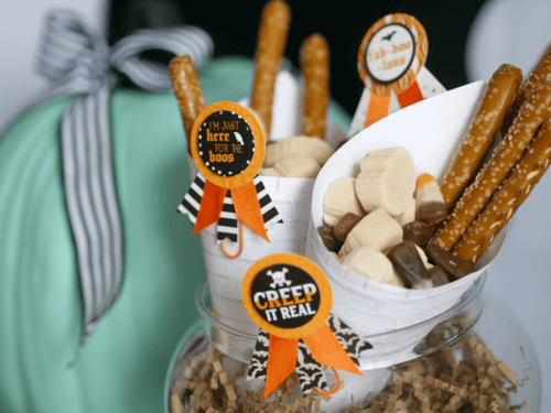 Creep It Real! This Teen Halloween Party is so unique and has the cutest food tags on the snacks that were served in paper cones. There's so many more Halloween party ideas from stylist Mint Event Design on the blog. #halloweenparty #partyideas #partyinspiration #halloween #halloweenideas #halloweendecorations #halloweensnacks