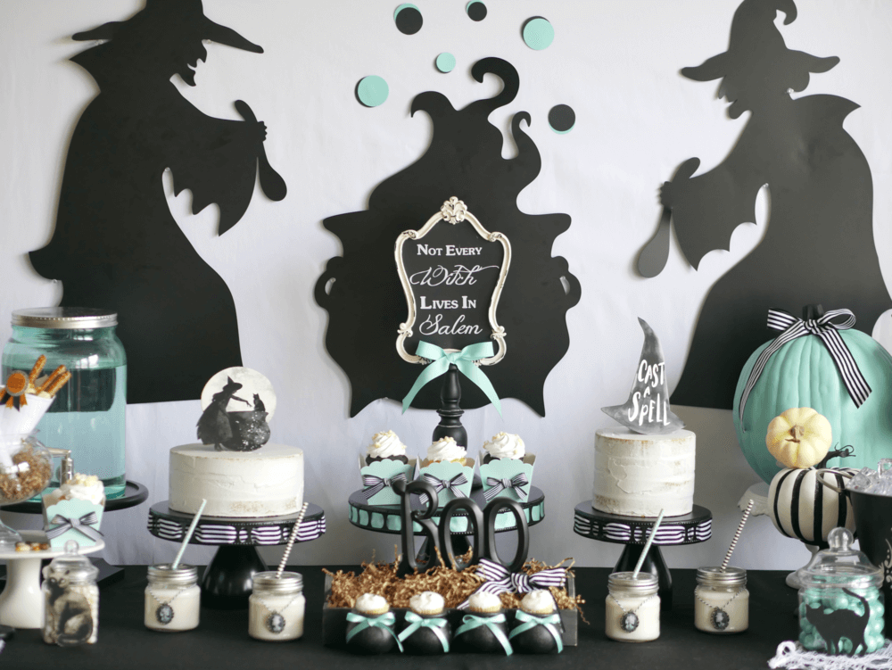 Have enough sweets already at your Halloween Party? Simply add to the dessert table for more balance with faux cakes. And, for a fun Halloween Dessert Bar backdrop, use oversize cutouts of witches stirring their potion. Click to see how the cute witch hat and witch with her cauldon cake toppers were created on the Mint Event Design blog. #halloweenparty #partyideas #partyinspiration #halloween #halloweenideas #halloweendecorations #halloweensdesserts #desserttable #dessertbar