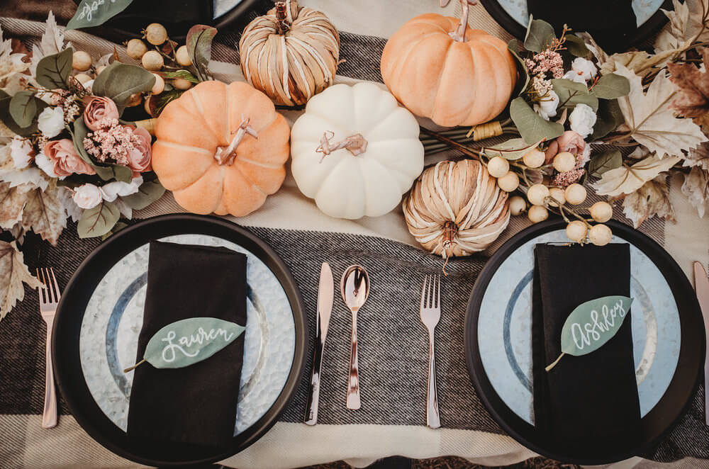 The prettiest fall centerpiece for bridal showers and weddings. Combine pumpkins and florals in natural colors and writes guests names on leaves with calligraphy. Click to see all the details of this fall bridal shower by party stylist Mint Event Design. #bridalshowers #bridalshowerideas #rusticwedding #rusticbridalshower #bridalshowerdecor #farmwedding #tablesetting #centerpiece #pumpkins #pumpkindecor #placecards