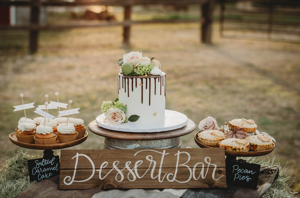 This drip frosted cake takes the spotlight at this Rustic Bridal Shower, along with mini salted caramel cupcakes and pecan pies. Click to see many more bridal shower ideas from this Fall in Love party theme. Created by party stylist Mint Event Design. #bridalshowers #bridalshowerideas #rusticwedding #rusticbridalshower #bridalshowerdecor #farmwedding #partyideas #fallbridalshower #dessertbar #pecanpies