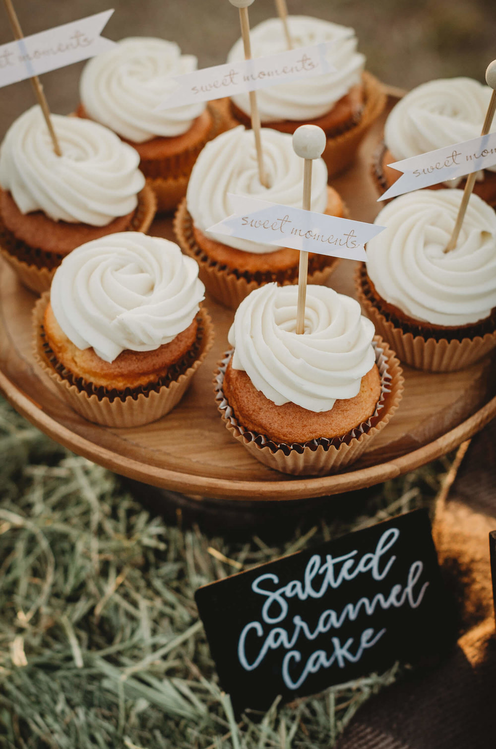 "Salted Caramel Cupcakes for a Rustic Fall bridal shower. Each cupcake is topped with a topper that reads ""sweet moments"". Click to see many more bridal shower ideas from this Fall in Love party theme. Created by party stylist Mint Event Design. #bridalshowers #bridalshowerideas #rusticwedding #rusticbridalshower #bridalshowerdecor #farmwedding #partyideas #fallbridalshower #bridalshowercupcake #bridaslshowerdessert"