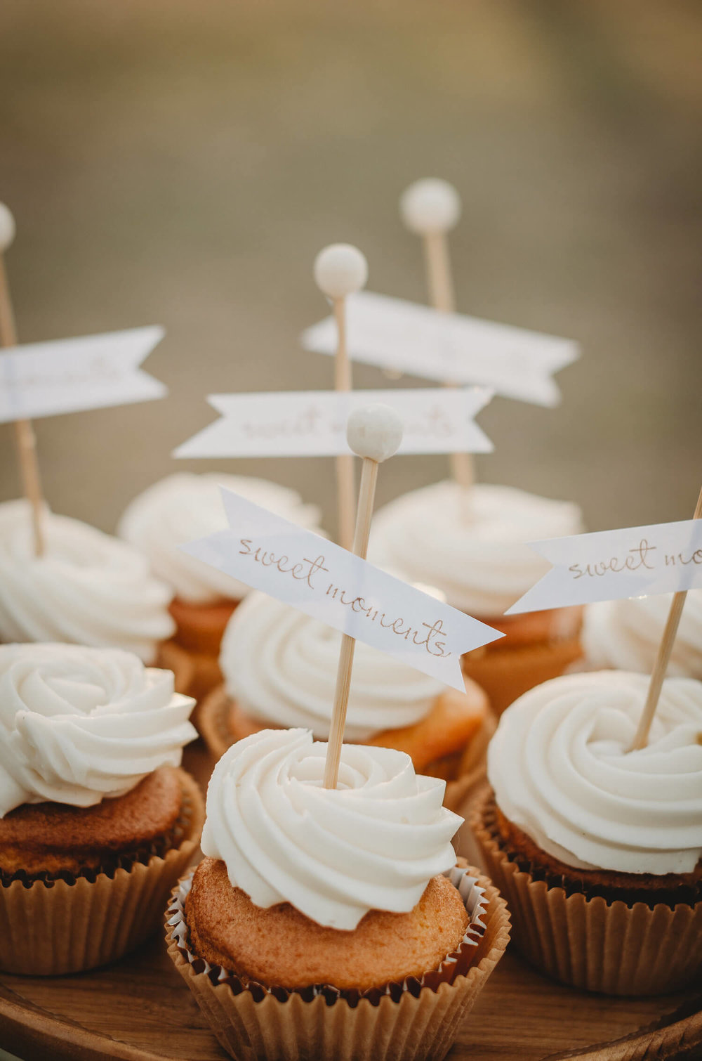 "Salted Caramel Cupcakes topped with a topper that reads ""sweet moments"" for a Rustic Fall bridal shower. Click to see many more bridal shower ideas from this Fall in Love party theme. Created by party stylist Mint Event Design. #bridalshowers #bridalshowerideas #rusticwedding #rusticbridalshower #bridalshowerdecor #farmwedding #partyideas #fallbridalshower #bridalshowercupcake #bridaslshowerdessert"