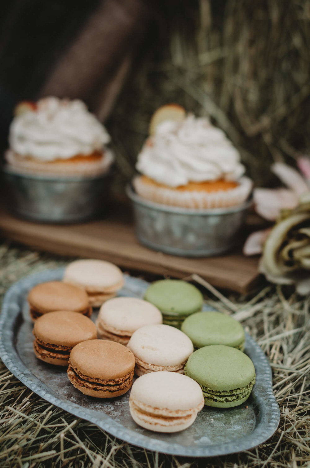Fall inspired colors were the inspiration for these macarons at a rustic bridal shower. Click to see many more bridal shower ideas from this Fall in Love party theme. Created by party stylist Mint Event Design. #bridalshowers #bridalshowerideas #rusticwedding #rusticbridalshower #bridalshowerdecor #farmwedding #partyideas #fallbridalshower #pecanpies #bridaslshowerdessert #minidesserts