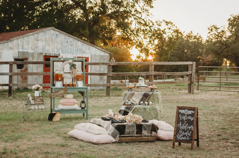 "Create your very own rustic celebration with ideas from this ""Fall in Love"" bridal shower . . . Click to see all the rustic details of this fall themed bridal shower that was held on a farm at sunset. Created by party stylist Mint Event Design. #bridalshowers #bridalshowerideas #rusticwedding #rusticbridalshower #bridalshowerdecor #farmwedding #partyideas #fallbridalshower"