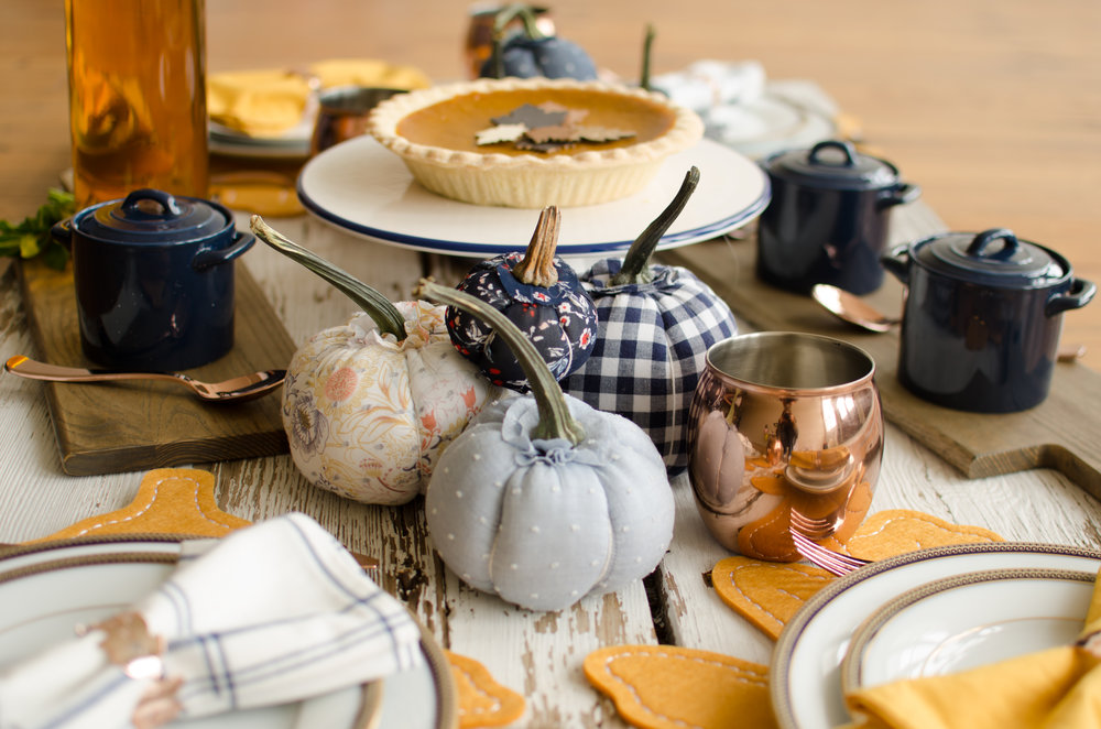 Whimsical fabric covered pumpkins and copper Moscow mule mugs will elevate your Thanksgiving table to another level. See how to combine the cozy and rustic decorations to create the most welcoming Thanksgiving Table with party planner, Mint Event Design in Austin, Texas on www.minteventdesign.com #thanksgiving #thanksgivingdecorations #tablescape #thanksgivingtable #pumpkins #tablesettings #fallparty