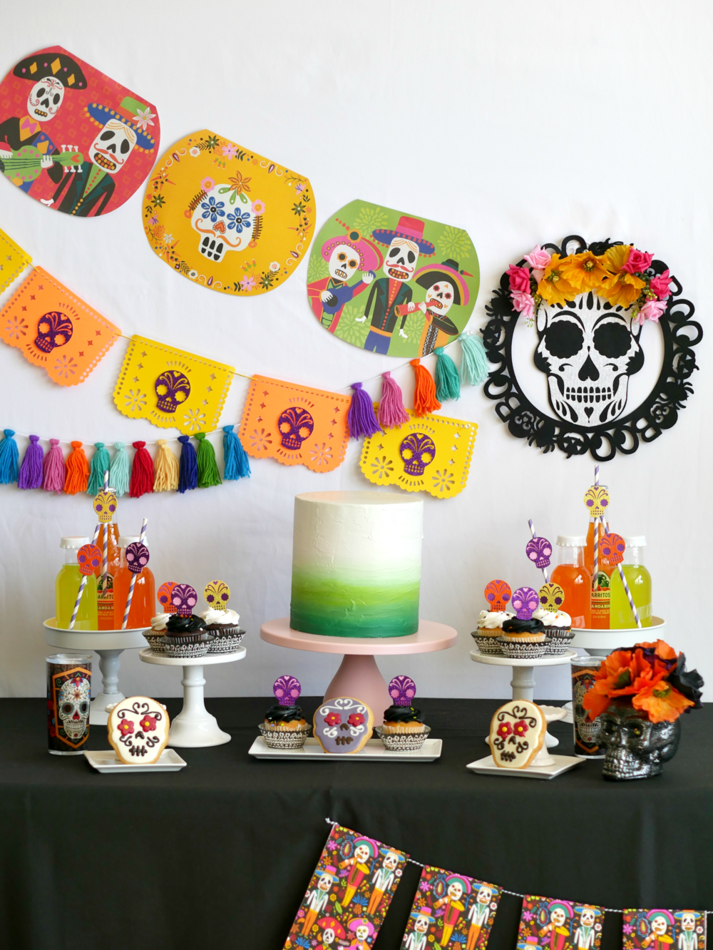 Let's celebrate Dia De Los Muertos with fringe garlands, sugar skulls, skeleton props and paper picado banners. Many more Day of the Dead party ideas for a dessert table on the Mint Event Design party blog from Austin, Texas based party stylist, Mint Event Design www.minteventdesign.com #dayofthedead #diadelosmuertos #sugarskulls #mexicanparty #halloweenparty #partyideas