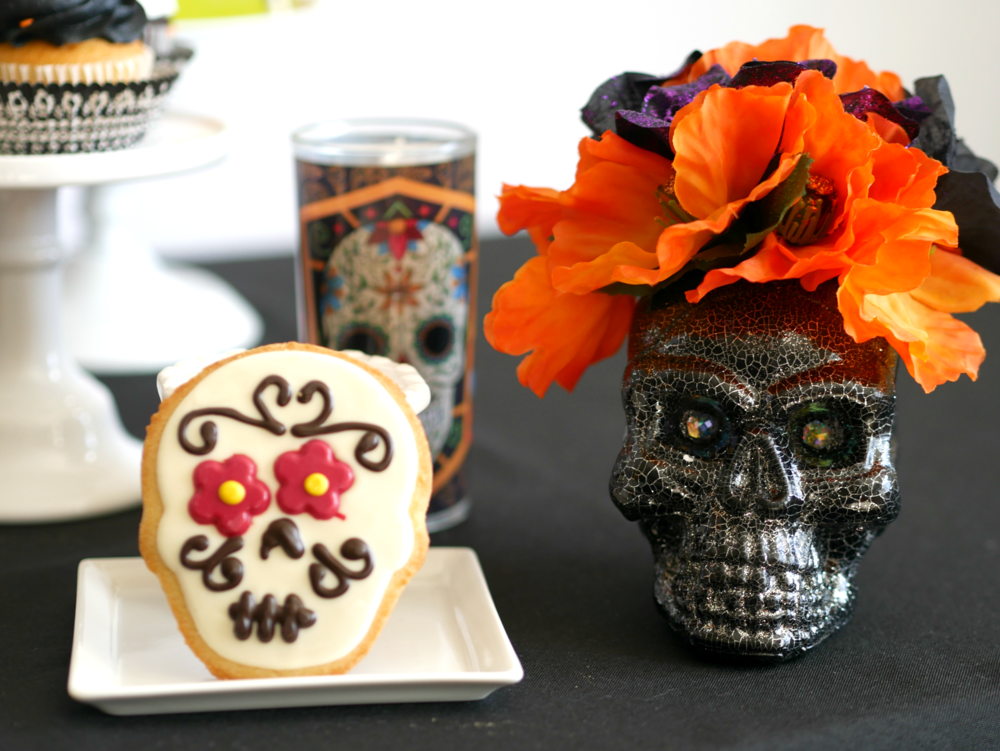Sugar skull decorations and treats are the highlight of this Day of the Dead Halloween Party. Find more Dia de Muertos party inspiration on the Mint Event Design party blog www.minteventdesign.com #dayofthedead #diadelosmuertos #sugarskulls #mexicanparty #halloweenparty #partyideas #papelpicado