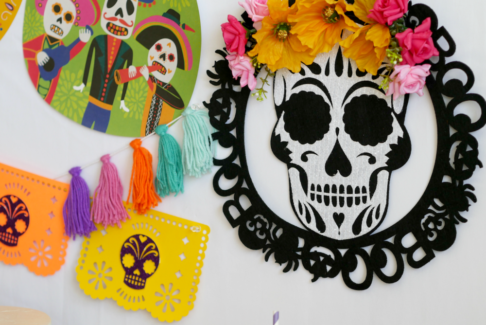Details of the pretty papel picado banner and other colorful Day of the Dead decorations. Find more Dia de Muertos party inspiration on the Mint Event Design party blog www.minteventdesign.com #dayofthedead #diadelosmuertos #sugarskulls #mexicanparty #halloweenparty #partyideas #papelpicado #partydecor