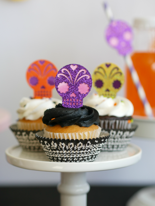 Bright and Colorful Skull Cupcakes are the perfect dessert decoration at this Dia de Los Muertos party. Find more Dia de Muertos party inspiration on the Mint Event Design party blog www.minteventdesign.com #dayofthedead #diadelosmuertos #sugarskulls #mexicanparty #halloweenparty #partyideas #cupcakes #cupcaketoppers