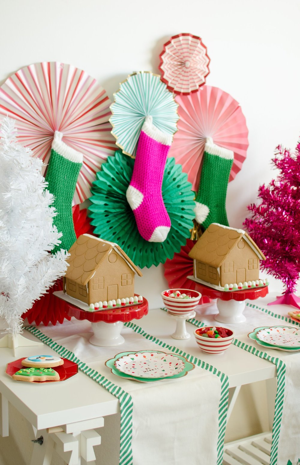 The candy is the star of the show at this gingerbread house party. See the full decorating details and party set up design on Mint Event Design www.minteventdesign.com #gingerbreadhouse #holidayparty #holidays #partyideas #christmasparty #holidaypartyideas #kidsparty