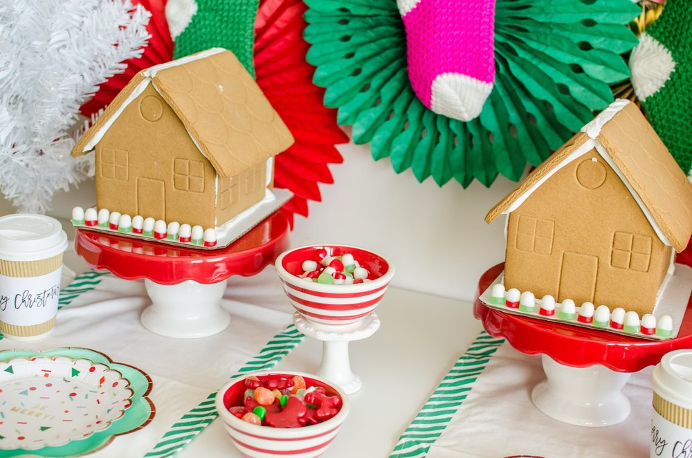 Party Planning Tip for a Gingerbread house decorating party: use cake stands to make it easy to display the gingerbread houses and store bought houses are perfect. Work smarter, not harder, right? See the full decorating details and party set up design on Mint Event Design www.minteventdesign.com #gingerbreadhouse #holidayparty #holidays #partyideas #christmasparty #holidaypartyideas #kidsparty