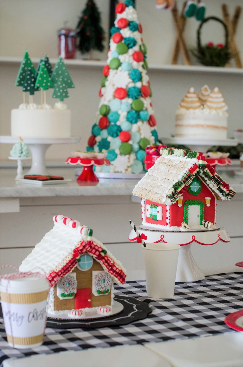 Now these are Gingerbread house goals! This holiday party is so beautiful! See more holiday party inspiration from Austin based party stylist Mint Event Design at www.minteventdesign.com #desserttable #christmasdesserts #holidayparty #holidays #partyideas #christmasparty #holidaypartyideas #gingerbreadhouses