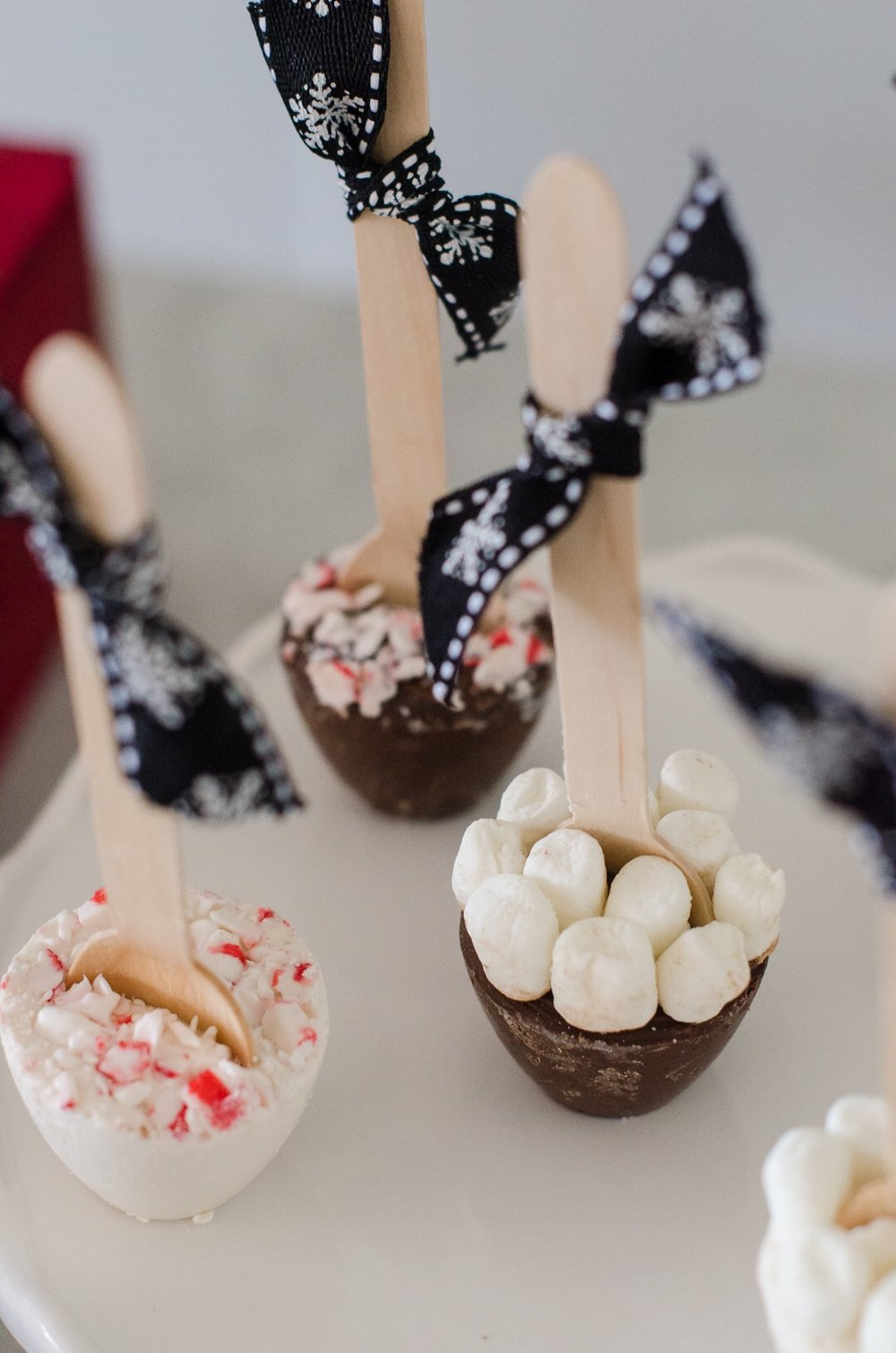 Hot cocoa stirrers for holiday parties will be such a treat for guests. See more holiday party inspiration from Austin based party stylist Mint Event Design at www.minteventdesign.com #holidayparty #holidays #partyideas #christmasparty #holidaypartyideas #hotcocoabar #hotcocoa