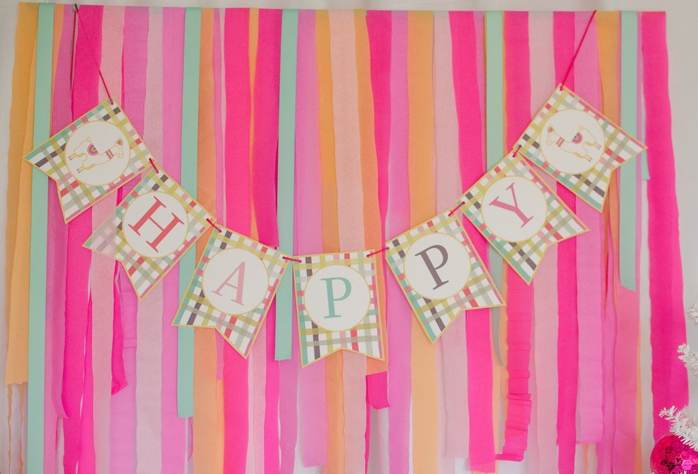 Party Decorating Tip: Create a picture perfect party backdrop with crepe paper draped over a bar and attach this Free Llama Party Printable Banner from Mint Event Design. See more from this llama Christmas party at www.minteventdesign.com and download your free printables #holidayparty #partyideas #christmasparty #holidaypartyideas #llamaparty #llamalove #partyprintables #freeprintables