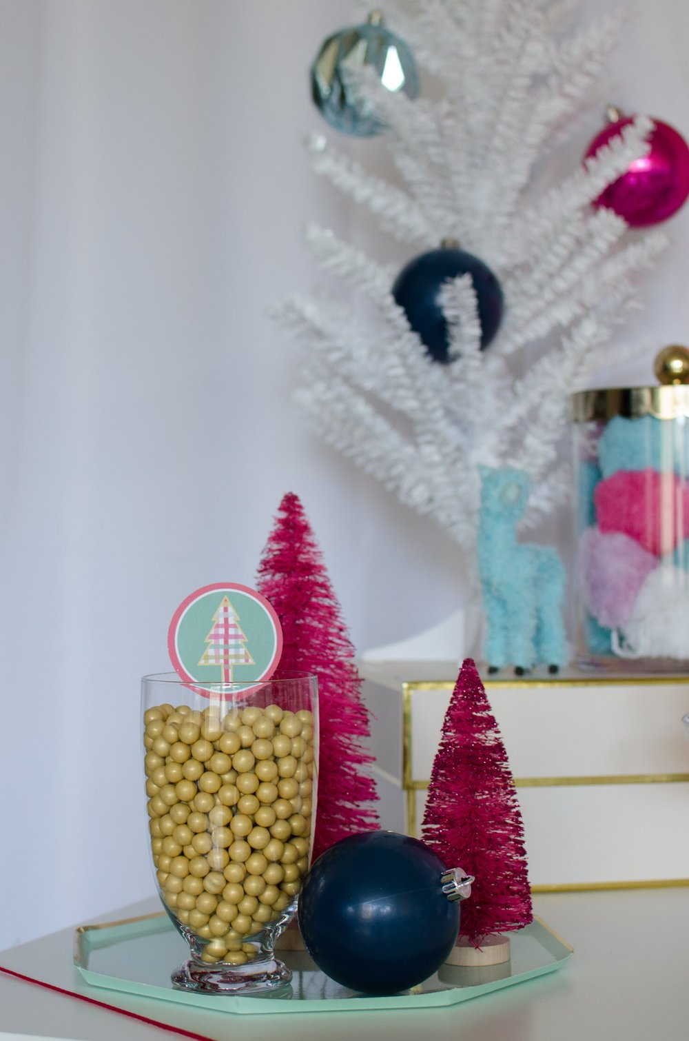Adding candy in glass jars dresses up the sweets table at this fa la la la llama holiday party from Mint Event Design. See more from this llama Christmas party at www.minteventdesign.com and download your free printables #holidayparty #partyideas #christmasparty #holidaypartyideas #llamaparty #llamalove