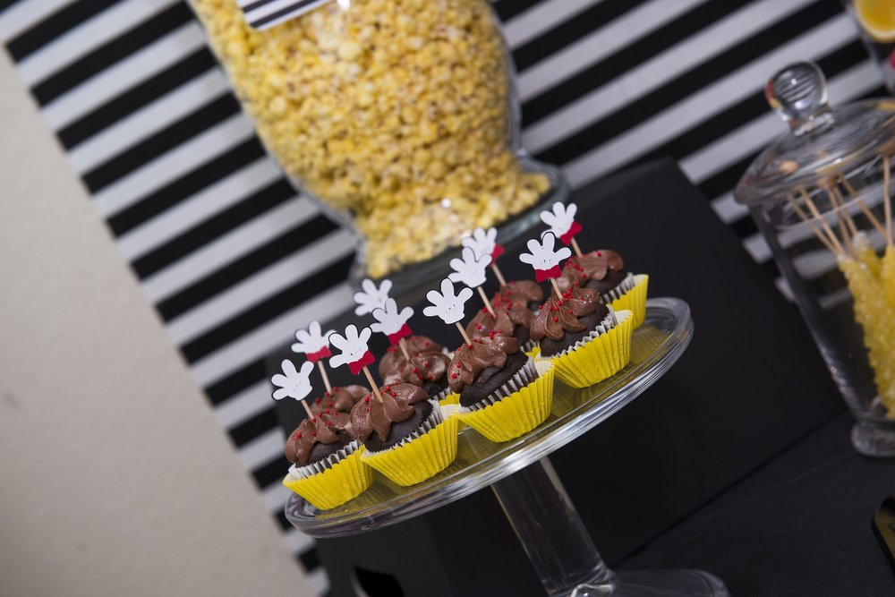 Yummy and adorable Chocolate cupcakes with Mickey Mouse toppers