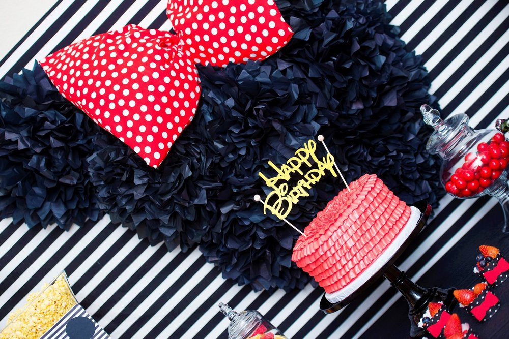 Beautiful backdrop and ruffled birthday cake, perfect for any Mickey mouse party