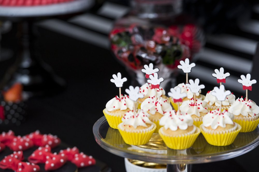 Vanilla cupcakes with sprinkles and Mickey Mouse glove toppers
