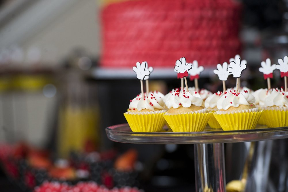 Cute Mickey Mouse glove cupcake toppers from Mickey themed birthday bash