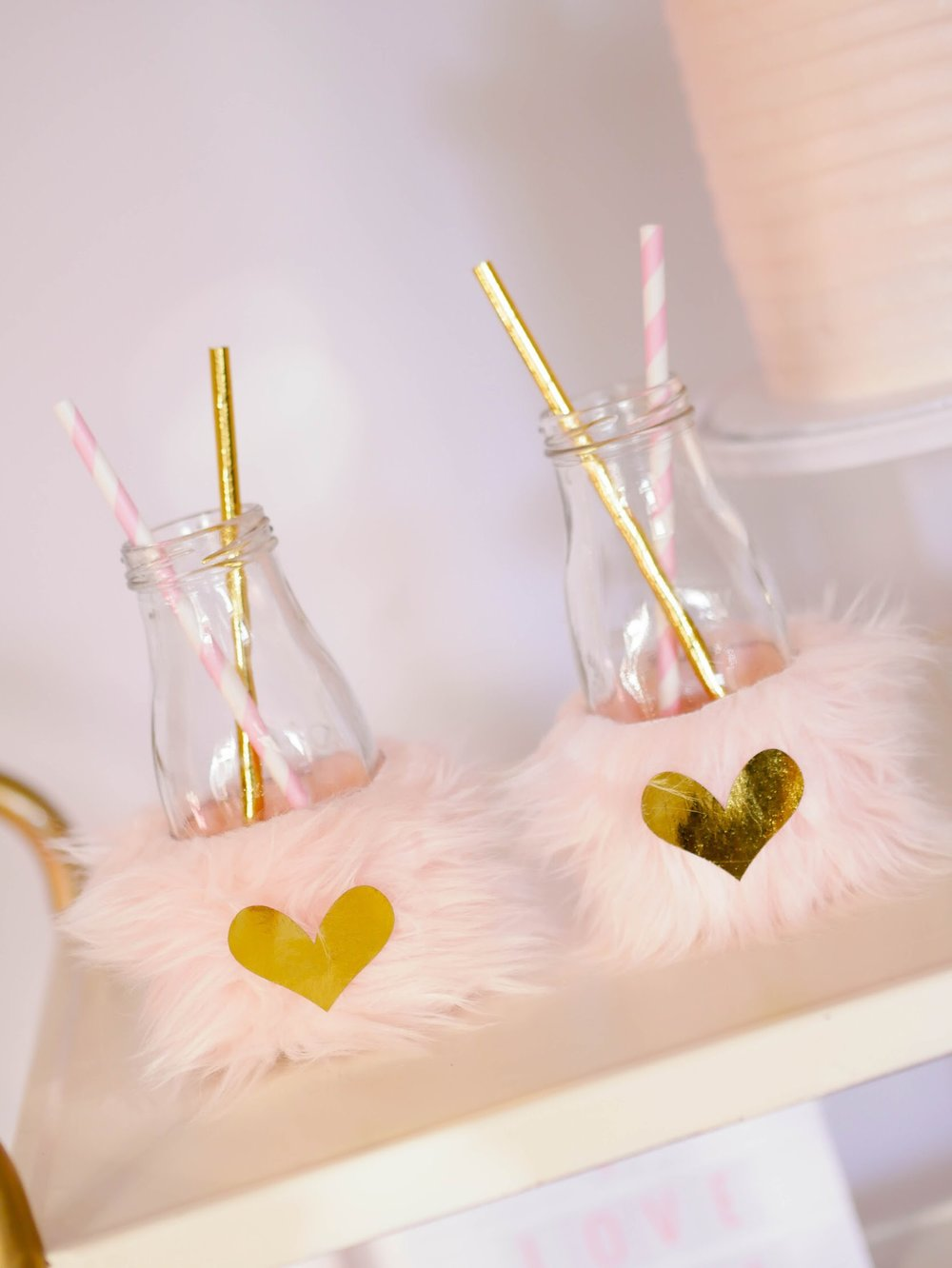Love this use of the golden straws and faux fur wrappers!