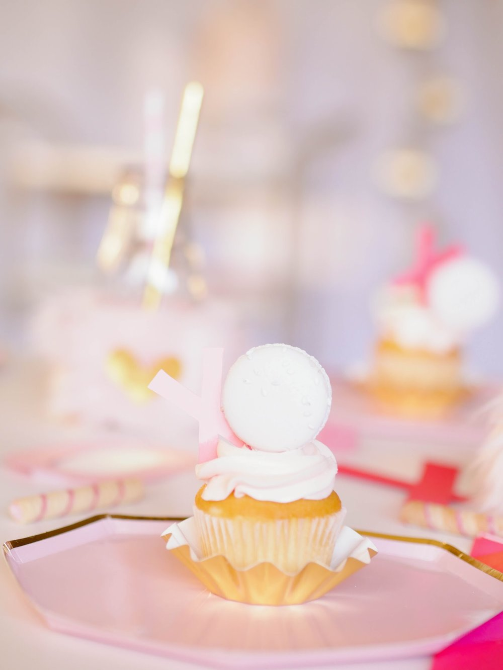 Cupcake toppers combine with Macarons to create a super sweet treat
