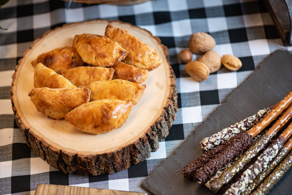 Mini Empanadas on on a wood plank gives this 40th birthday a rustic look