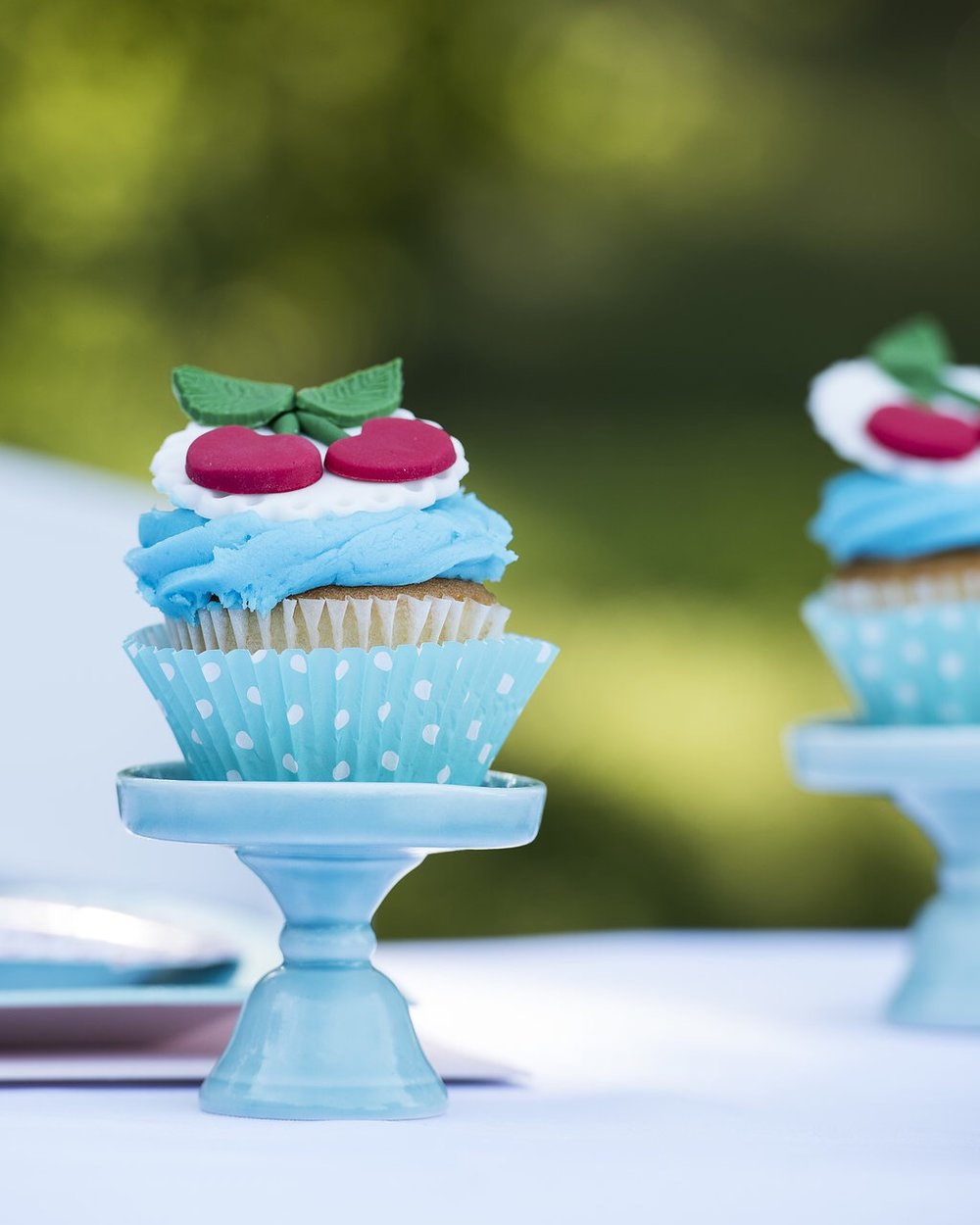 The cutest blue cupcake stands for Cherry on Top themed birthday party cupcakes. Created by Mint Event Design in Austin Texas www.minteventdesign.com #summerparties #partyideas #kidspartyideas #partyplanning #birthdaypartyideas #kidsparty #cherryparty #cupcakes