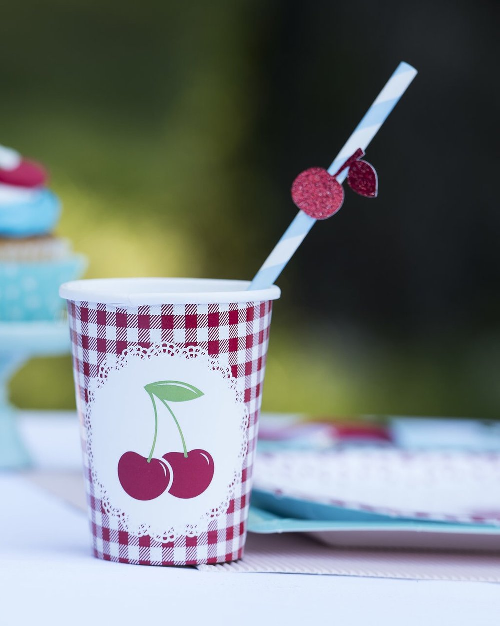 Love this gingham cherry birthday themed party with the cutest party supplies. Styled by Mint Event Design in Austin Texas www.minteventdesign.com #summerparties #partyideas #kidspartyideas #partyplanning #birthdaypartyideas #kidsparty #cherryparty #partysupplies