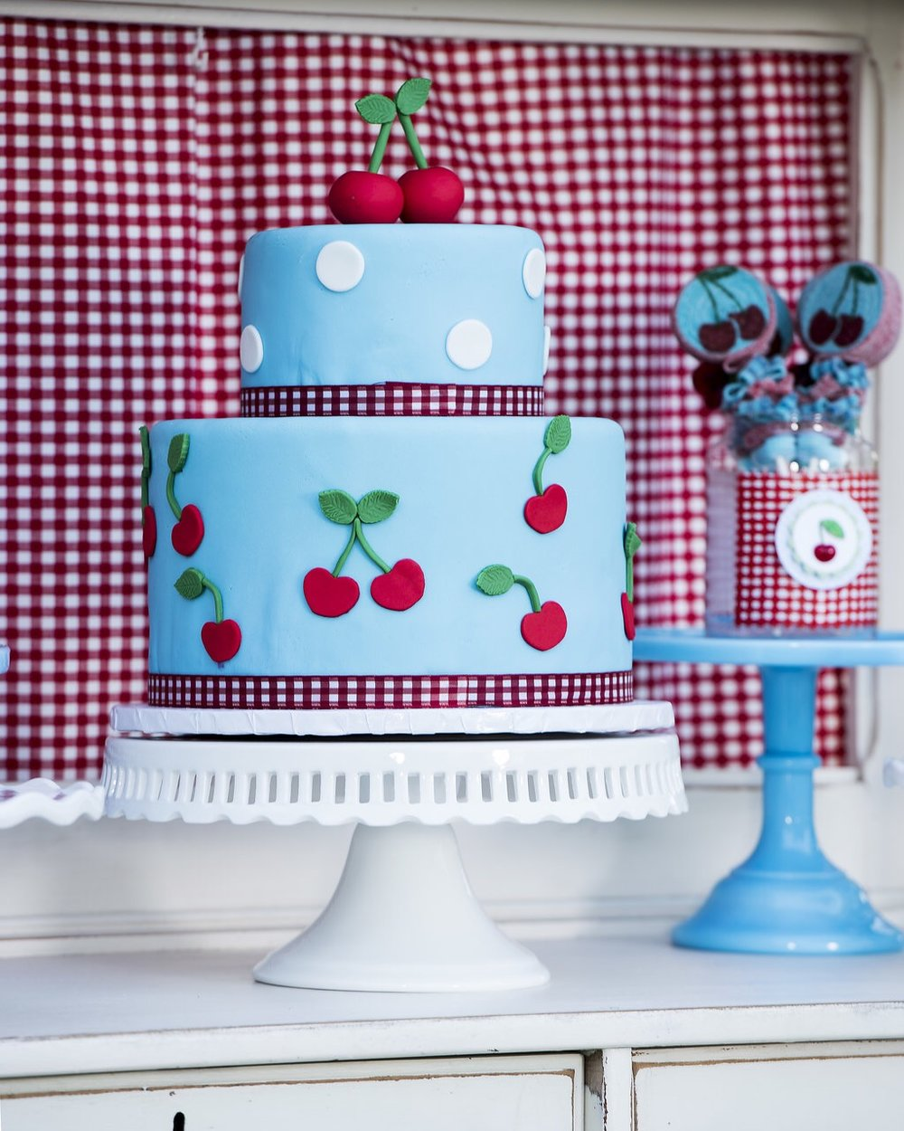 The prettiest Cherry on Top party cake for summer birthday parties. Created by Sweet Carousel Cakes - as seen on Mint Event Design www.minteventdesign.com #summerparties #partyideas #kidspartyideas #partyplanning #birthdaypartyideas #kidsparty #cherryparty #partycake