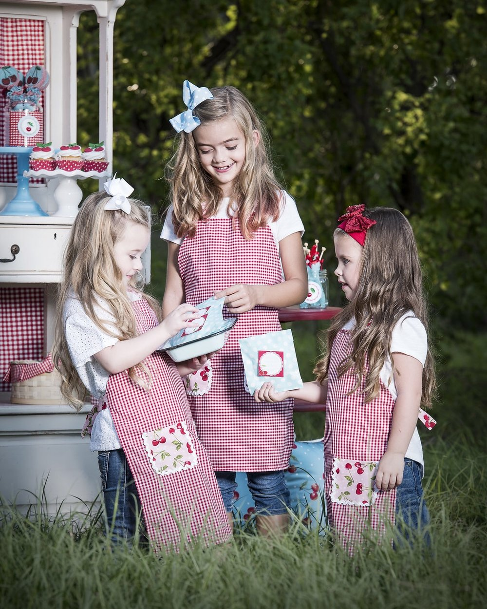 Love the idea of giving each girl a cute Cherry apron to match the Cherry on Top party theme. Such a fantastic party favor idea for girls. See lots more from this summer party on Mint Event Design in Austin Texas www.minteventdesign.com #summerparties #partyideas #kidspartyideas #partyplanning #birthdaypartyideas #kidsparty #cherryparty