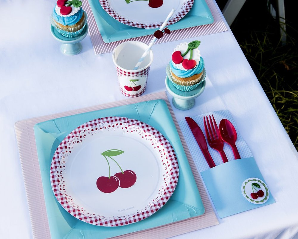 Adorable cherry themed birthday party supplies for a summer celebration. As seen on Mint Event Design www.minteventdesign.com #summerparties #partyideas #kidspartyideas #partyplanning #birthdaypartyideas #kidsparty #cherryparty