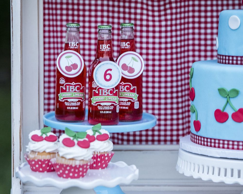 Cherry sodas and fondant cherry topped cupcakes complete this Cherry on Top themed party by Mint Event Design www.minteventdesign.com #summerparties #partyideas #kidspartyideas #partyplanning #birthdaypartyideas #kidsparty #cherryparty