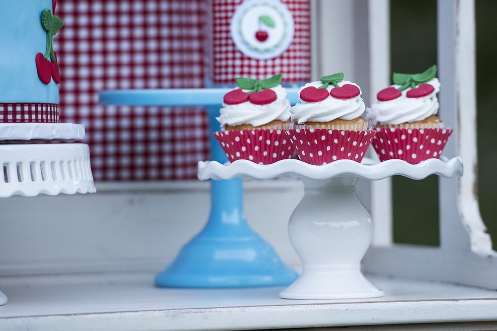 Birthday cupcakes with a cherry on top. Too cute for a sweet birthday party - as seen on Mint Event Design www.minteventdesign.com #summerparties #partyideas #kidspartyideas #partyplanning #birthdaypartyideas #kidsparty #cherryparty