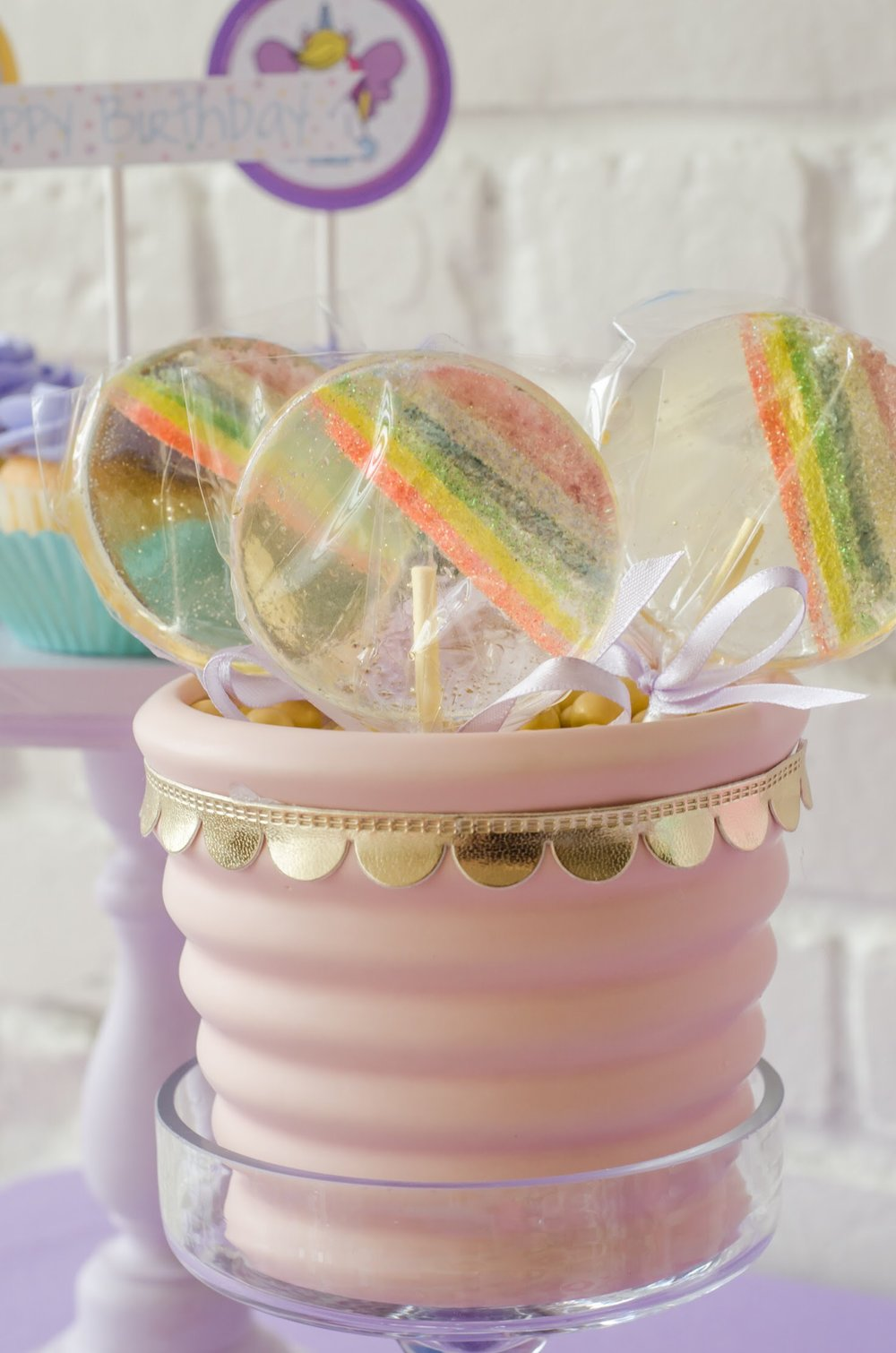 Rainbow lollipops are the perfect addition to this unicorn party created by Mint Event Design www.minteventdesign.com #unicornparty #lollipops #birthdayparty #birthdaypartyideas #pastelrainbow