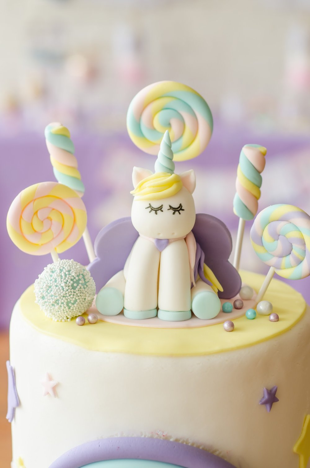 This is the cutest Unicorn Birthday Cake Topper ever! Look at those eye lashes! Come see all the Unicorn Birthday Party Ideas at Mint Event Design www.minteventdesign.com #unicornparty #birthdayparty #birthdaypartyideas #pastelrainbow #birthdaycake