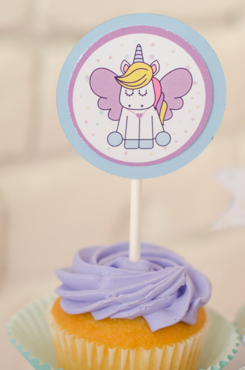 Free printable unicorn cupcake toppers. See more from this adorable unicorn themed birthday party created by Mint Event Design www.minteventdesign.com #unicornparty #birthdayparty #birthdaypartyideas #birthdaydesserts #freeprintables
