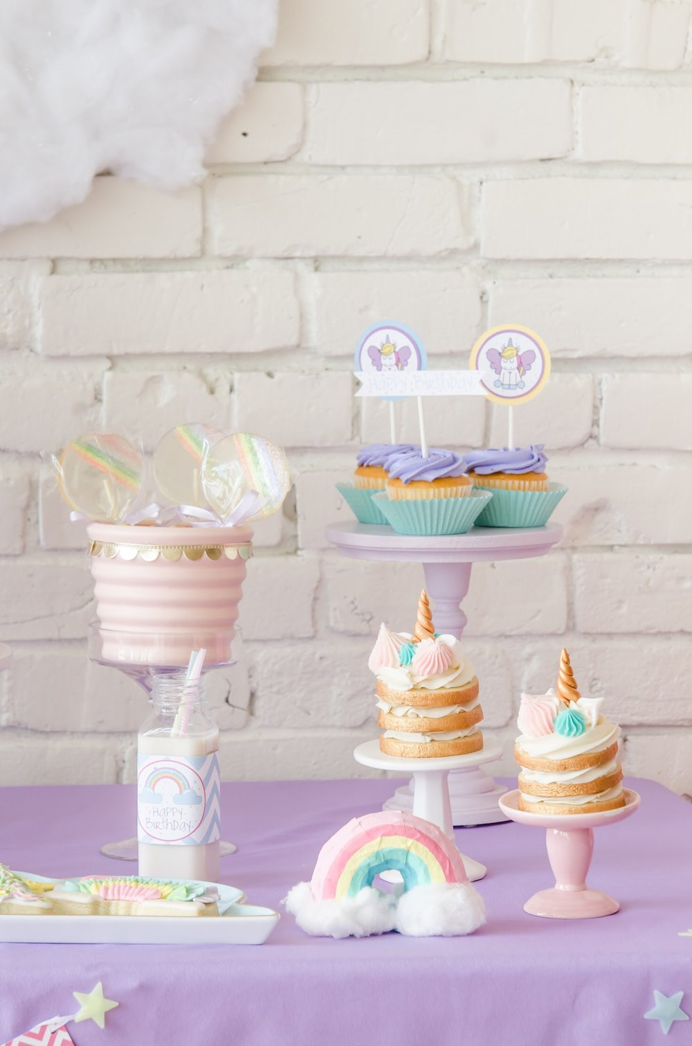 Find out how to create these super cute paper mâché rainbows from this pastel rainbow Unicorn party. All the Unicorn Birthday Party Ideas can be found at Mint Event Design www.minteventdesign.com #unicornparty #birthdayparty #birthdaypartyideas #pastelrainbow #papermache