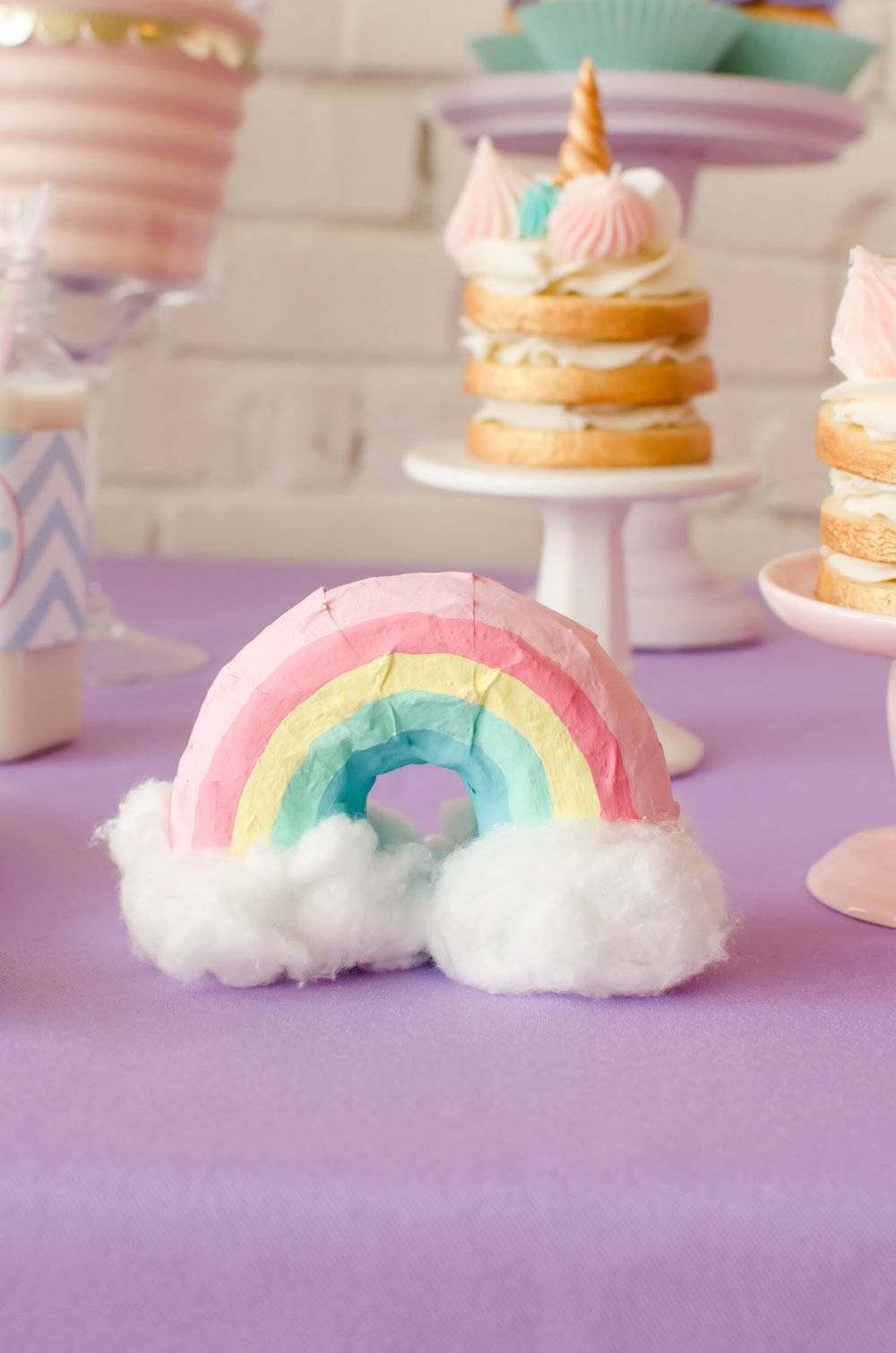 Rainbow paper mâché project from a pastel unicorn birthday party. See more from this unicorn rainbow party at Mint Event Design www.minteventdesign.com #unicornparty #unicornbirthday #birthdayparty #birthdaypartyideas