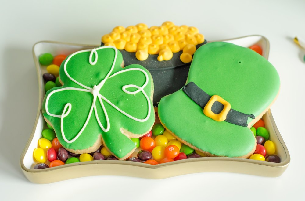 The perfect St. Patrick's Day dessert tray - serve St. Patrick's Day themed sugar cookies on a tray with some rainbow candy - shown here with Skittles. See more party ideas on Mint Event Design www.minteventdesign.com #partyideas #partydecorations #sugarcookies #saintpatricksday #stpatricksday #desserttray