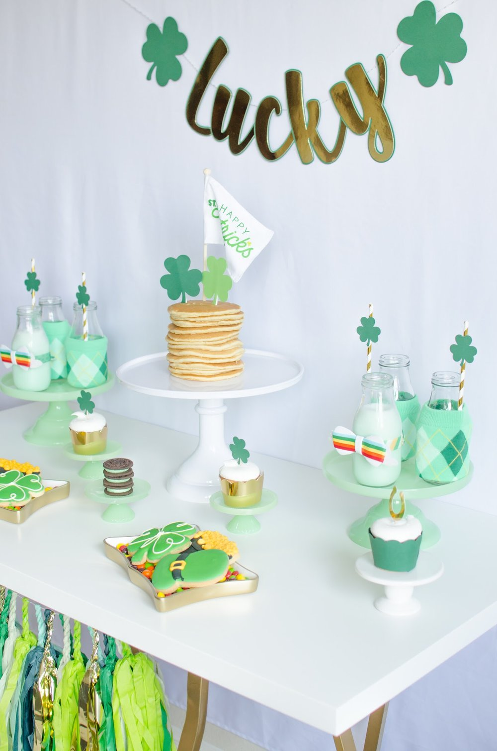 Love all the shades of green and gold in this St. Patrick's Day breakfast party from Mint Event Design www.minteventdesign.com #partyideas #partydecorations #saintpatricksday #stpatricksday #tablescape #desserttable