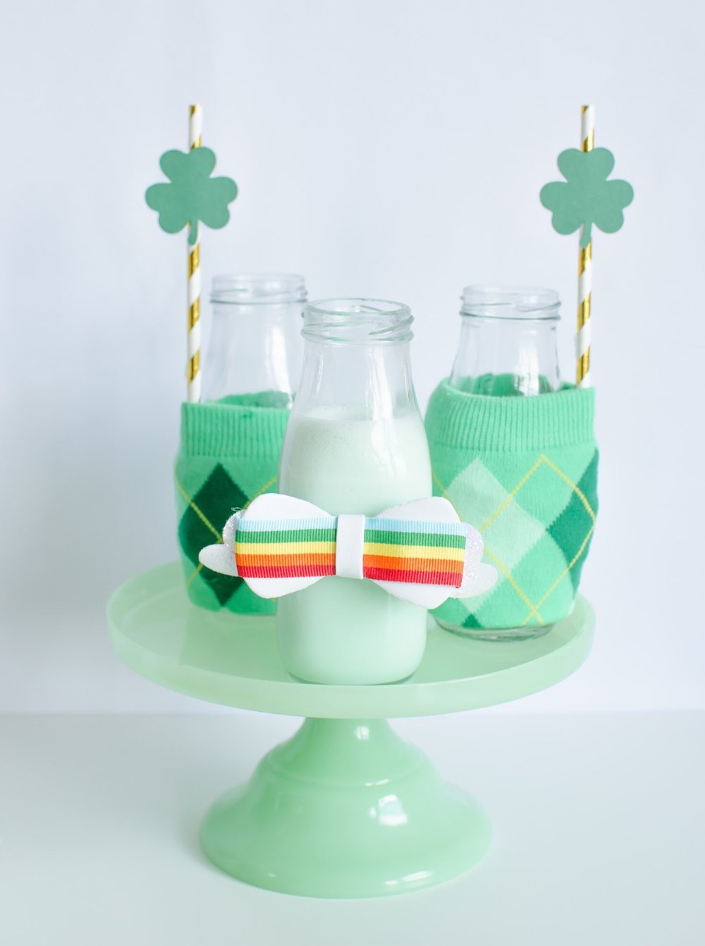 St. Patrick's Day DIY Milk Bottle Wrappers— see how to create this super cute idea from Mint Event Design www.minteventdesign.com #partyideas #partydecorations #saintpatricksday #stpatricksday #diycrafts