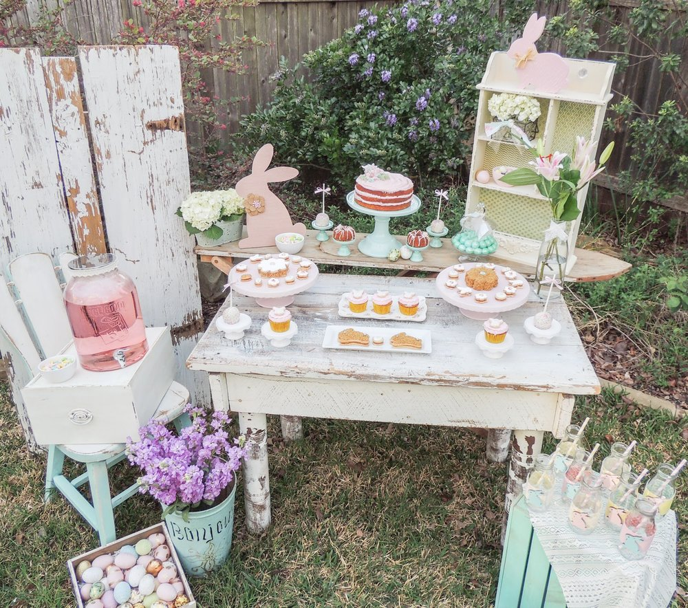 The Cutest Shabby Chic Easter Decor for a Dessert Party at your Easter Egg Hunt. A pretty pastel color palette and a tiered carrot cake with mini bundt cakes were the spotlight of this Easter Dessert Table. Styling by Austin Texas Party Planer Mint Event Design www.minteventdesign.com #eastertable #easterdecor #easterparty #partyideas #easterideas
