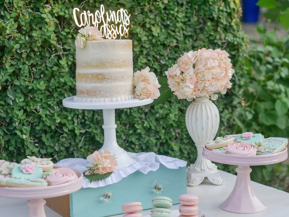 Add pastel florals to create a vintage feel to your dessert party. As seen on Mint Event Design www.minteventdesign.com
