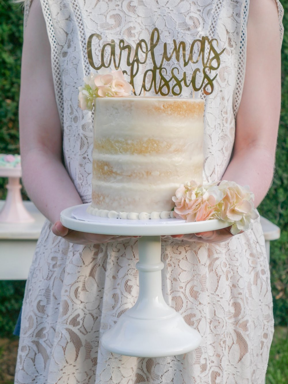 Unfrosted cake and metallic gold topper. Love this style for garden parties and even bridal showers. See more garden party ideas on Mint Event Design www.minteventdesign.com #dessertparty #partytips #partyplanning #partyideas #partycake #caketopper