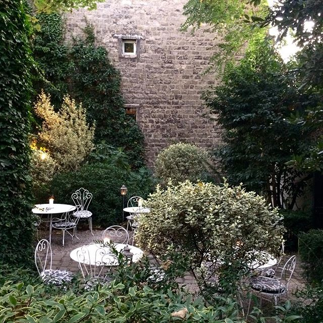 This secret Parisian garden must be the most tranquil and romantic spot I've ever enjoyed an evening. Cheers to @blakemaaan and @emhutch18 in celebration of your marriage tomorrow. These guys do it up right! Love you both a ton! 🇫🇷🥂🍾