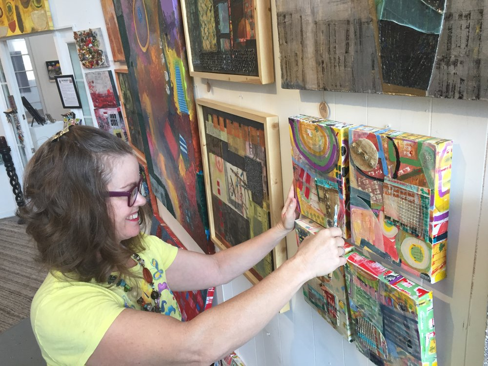 Artist, Adrienne Forshner Kinsey in her studio preparing for an open house